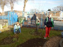 Preparing beds for wildflowers in Mallard Community Orchard