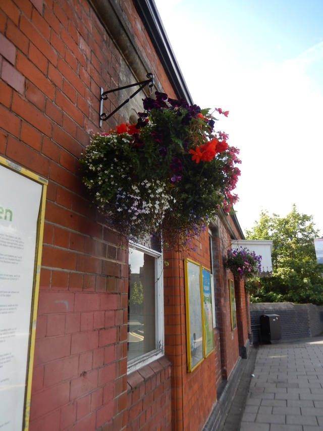 Hanging baskets at Acocks Green Train Station