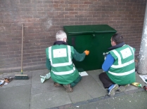 Mick and Paul repainting box with Heritage Green