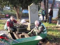 Men at Work. Mick and George working hard tidying gravestones