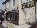 Building owner John Alder supports the Bloom project by arranging repainting of building.