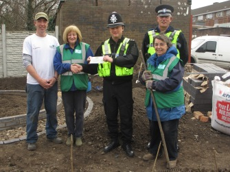 Volunteers - Phil, Fran and Ann being presented cheque from Sgt Fellows and PCSO Large
