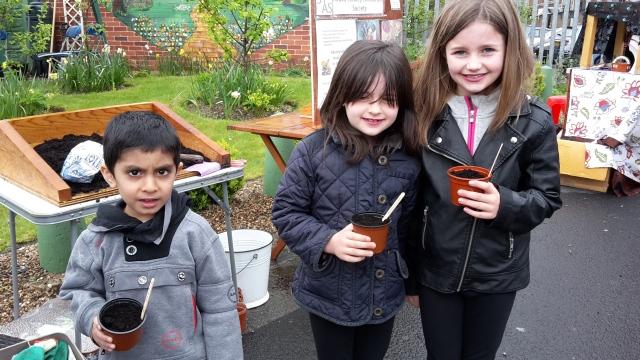 Children sowing nasturtium seeds
