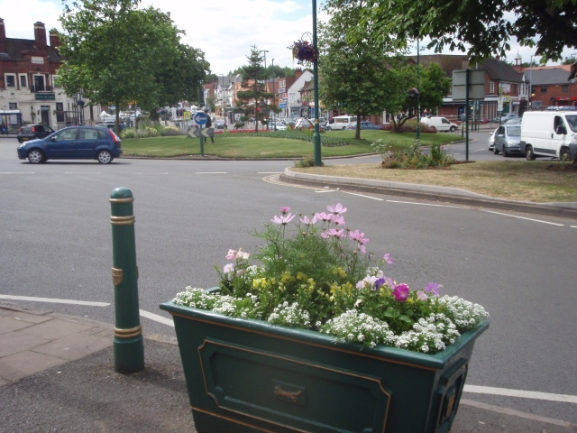 One of the existing colourful planters with flowers from Jeffries