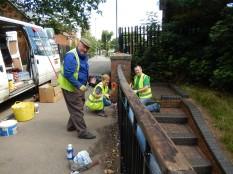 Dave, Elaine and John painting railings